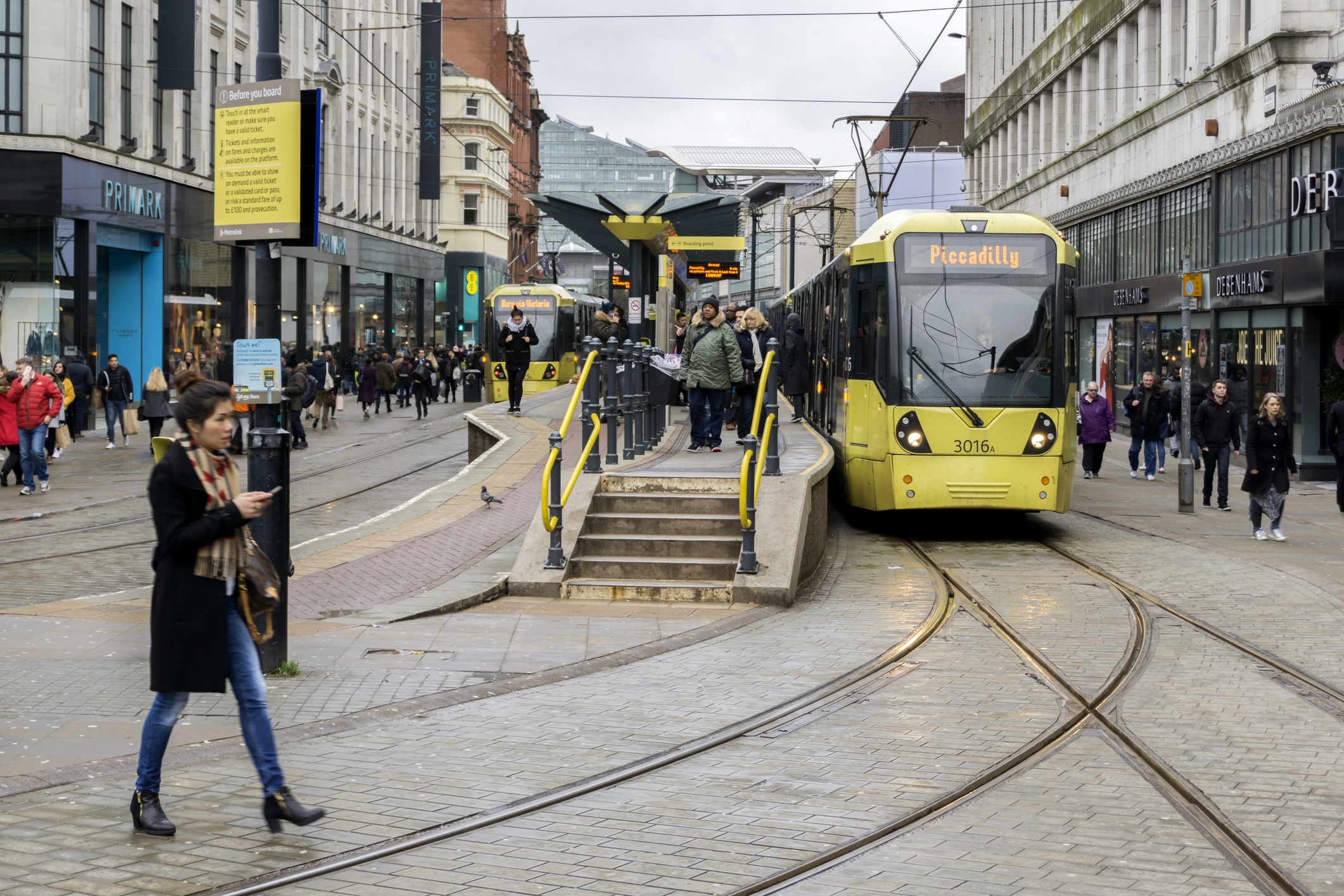 People use yellow tram to commute to Manchesters best branding agencies