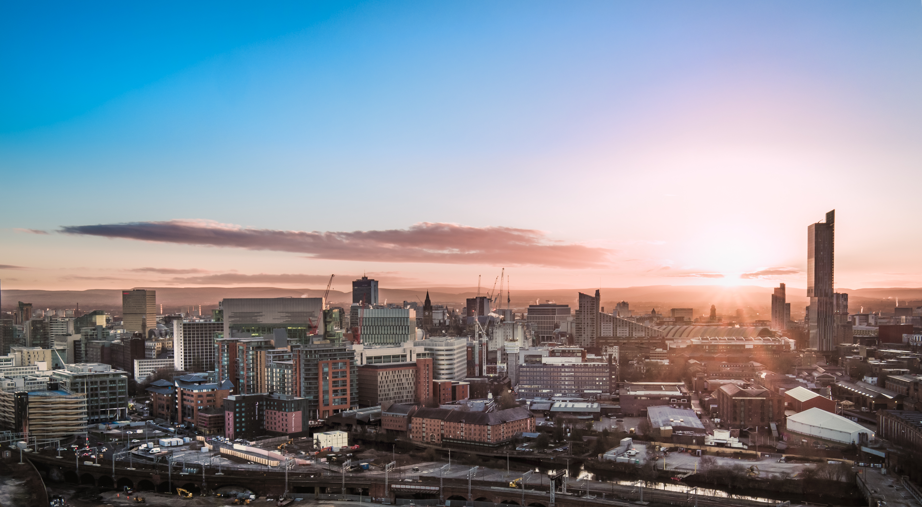 Skyline view of Manchesters best branding agencies at sunrise